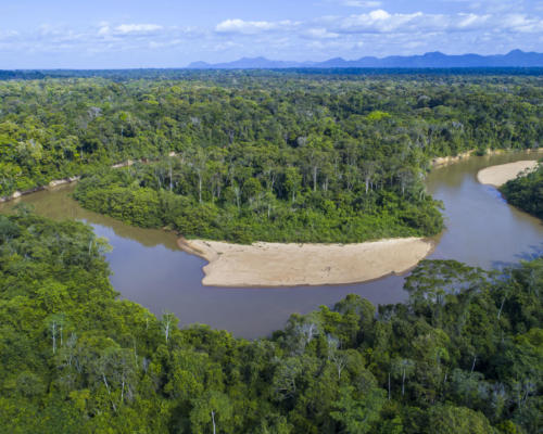 An aerial photo taken with a drone over the Kanuku Mountains Protected Area, Guyana. The Rupununi River flows from the mountains. © Daniel Rosengren